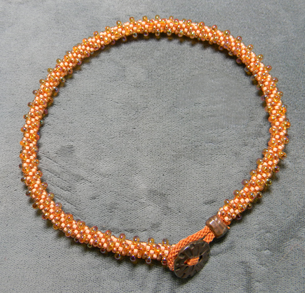 Kumihimo Bracelet No. 41 can be made as a bracelet or extended to be worn as an ankle bracelet.